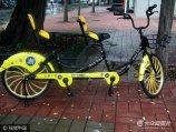 """2017年7月18日,北京,继多种颜色共享单车、共享电动车之后,一款""""共享双车""""悄然出现在民族大学校园。"""
