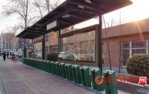 济南公共自行车站加了雨棚,万事俱备只欠东风