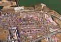 2017年1月15日,航拍器拍摄的山东省日照市东港区南湖镇年货大集。随着农历鸡年春节的临近,人们开始忙着选购山珍海味、水果、烟酒等年货,迎接新春佳节的到来。