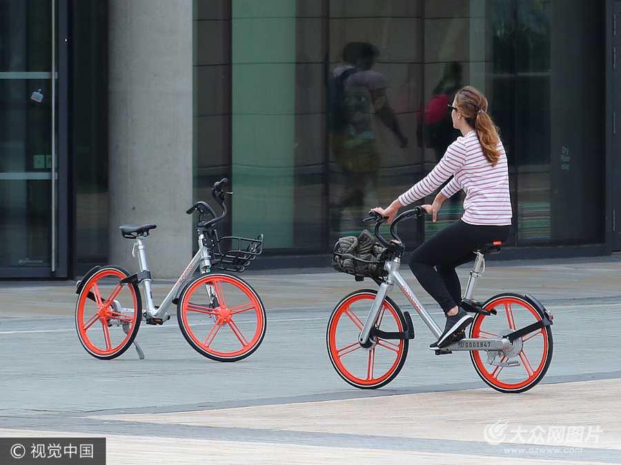 摩拜单车曼城刷街 获媒体点赞俘获一票迷弟迷妹