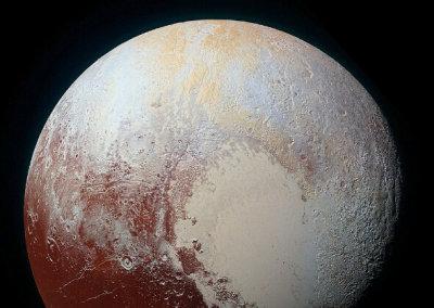 NASA发布冥王星新照 现蓝色天空和红色水冰