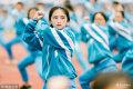 2018年11月5日,广东省惠州市实验中学2018级新生军训成果汇报表演。军体拳方阵,一位女生正认真打拳。