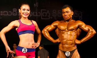 缅甸举办健美大赛 肌肉男和美女同场秀身材